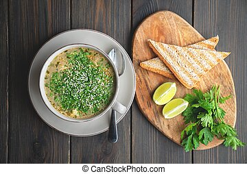 Bowl of soup with seafood with toast