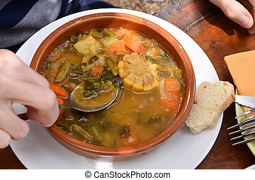 Bowl of Spanish vegetable soup on the table