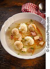 Bowl of spring broth with bone marrow dumplings