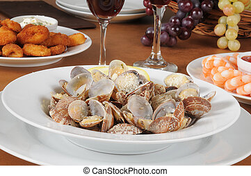 A bowl of steame3d clams topped with parmesan cheese