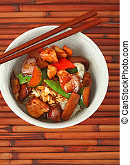 Bowl of Stewed Chicken over White Rice