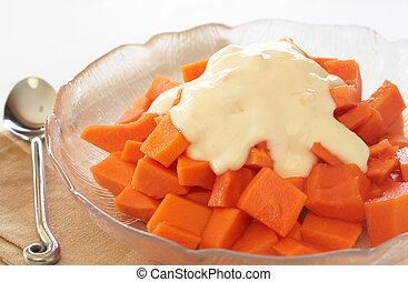 Bowl of summer papaya fruit salad with topping of fresh...