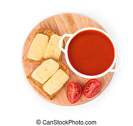 Bowl of tomato soup with toast.