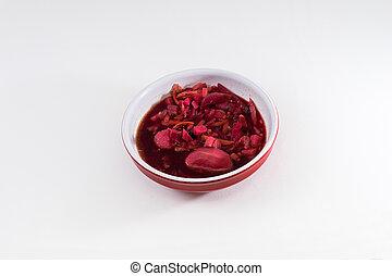 Bowl of Ukrainian food borsch on white background