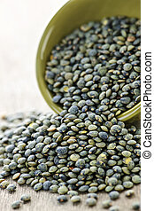 Bowl of uncooked French lentils - Bowl full of raw french...