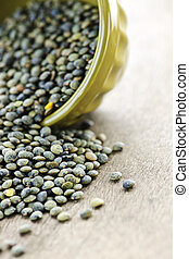 Bowl of uncooked French lentils