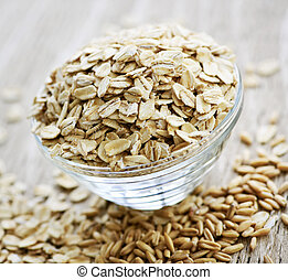 Nutritious rolled oats heaped in a glass bowl