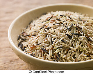 Bowl of Uncooked Wild, Basmati and Red Carmague Rice