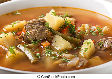 Bowl of vegetable beef soup - Close up of bowl of vegetable...