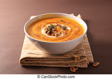 bowl of vegetable soup and cream