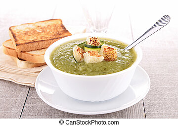 bowl of vegetable soup with crouton