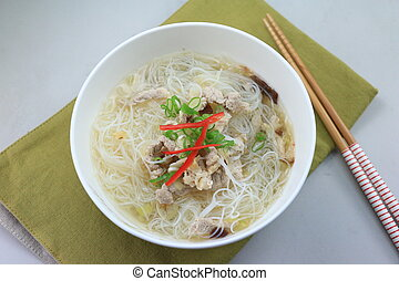 Bowl of vietnamese rice vermicelli noodle with beef on the table