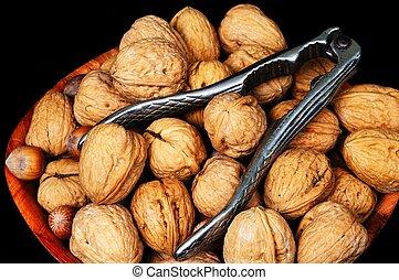 Bowl of walnuts and hazelnuts.