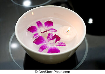 Bowl of Water with Orchids and Floating Candle