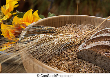 Bowl of Wheat Grains, Flour and Bread