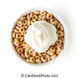 Bowl of Whole Grain Cheerios Cereal and yogurt isolated on white background, top view