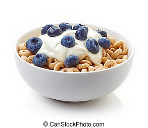 Bowl of Whole Grain Cheerios Cereal with blueberries and yogurt isolated on white background