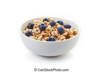 Bowl of whole grain cheerios cereal with blueberries isolated on white background