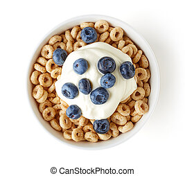 Bowl of Whole Grain Cheerios Cereal with blueberries and yogurt isolated on white background, top view