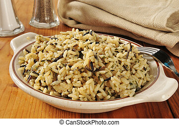 A bowl of wild and long grain rice with herbs