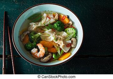 Bowl of wonton dumpling soup wth shrimp