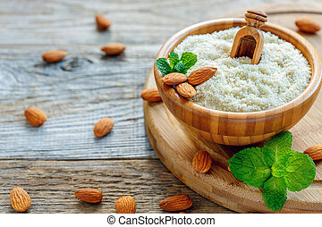 Bowl with almond flour on a wooden stand.