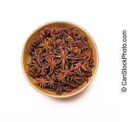 bowl with anise star on white background