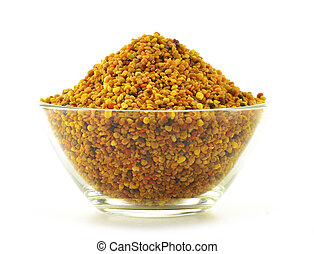 Bowl with bee pollen isolated on white. Nutritional...
