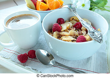 Bowl with cereals and berries with cup of coffee