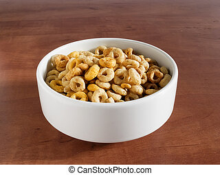 Bowl with cheerios whole grain cereals on a table