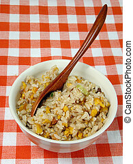 Bowl with Chinese rice on a table