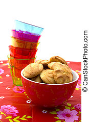 Bowl with cookies and a stack of glasses
