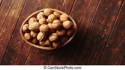 Bowl with fresh walnuts - From above shot of bowl with whole...