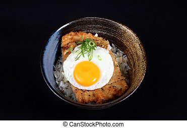bowl with fried fish, rice and egg