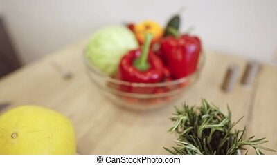 Bowl With Fruits And Vegetables On The Table Of Modern Kitchen