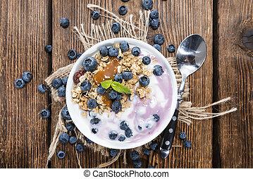 Bowl with homemade Blueberry Yogurt and caramel sauce
