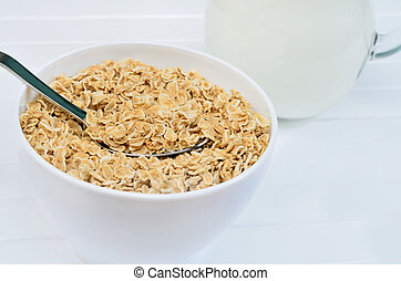 Bowl with oat on table