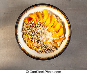 Bowl with oatmeal and fresh fruit, top view