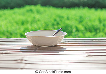 Bowl with on old wooden
