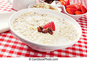 bowl with porridge on a set table for breakfast