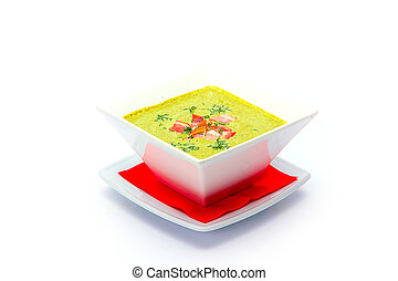 Bowl with pumpkin soup on white background.