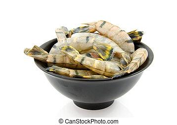 Bowl with raw shrimp
