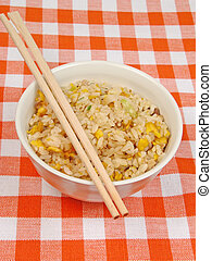 Bowl with rice on a table