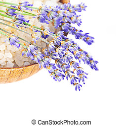 Bowl with salt and lavender flowers isolated on white background, fresh purple floral bouquet on wooden plate, conception of day spa, relaxation, health care, herbal cosmetics, alternative medicine