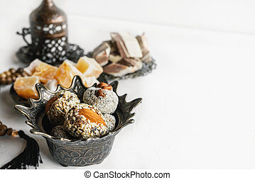 bowl with various pieces of Turkish delight and Oriental sweets on a light background. copy space.