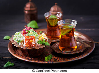 Bowl with various pieces of turkish delight lokum and black ...
