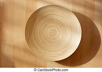 Wooden bowl on the carpet
