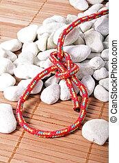 Bowline Knot - A fine knotted bowline knot lying on a pile ...