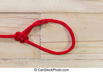 bowline knot made from red synthetic rope, tightening on ...