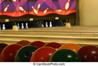Bowling Abstract - Bowling balls in the foreground, lanes in...